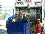 Foto #60375 - Child waste pickers in a truck of the municipality in the Rambla del Buceo